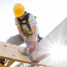 construction worker hammering roof